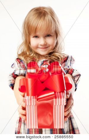 Little cute girl giving a gift in a beautifully  wrapped gift box