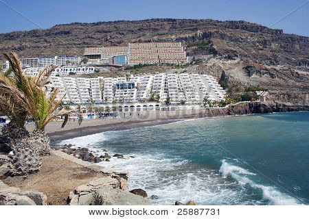 The beach and sea front at playa taurito in Gran Canaria