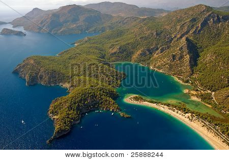 Paragliding over turquoise bay