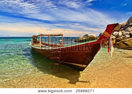 Longtail boat in tranquil bay