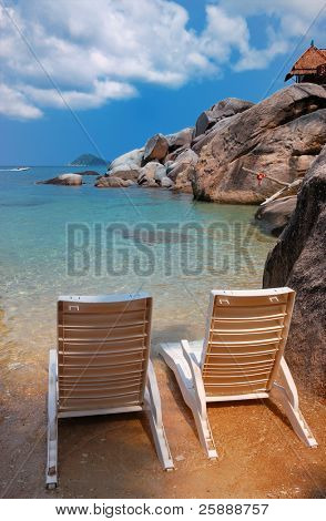 Two sunbeds on a private beach