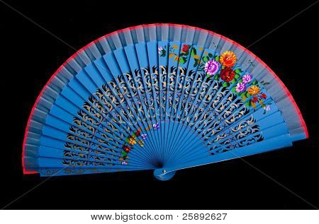 China blue hand fan isolated on black background