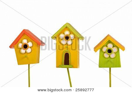 Three colorful bright starling-houses isolated on white background
