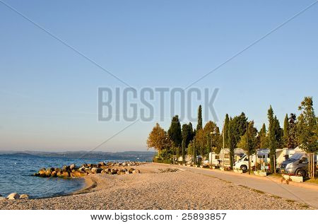 Garda Lake coastline with motorhomes campsite, Italy