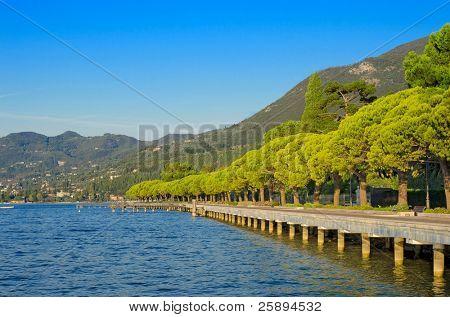 Pedestrian alley on the banks of Garda lake, Toscolano, Italy