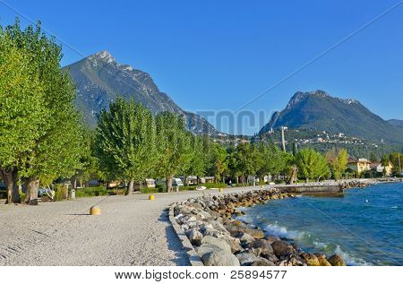 Alley covered with pebbles on the banks of Garda lake, Italy