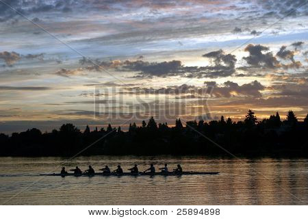 people rowing on green lake at sunrise in seattle washington