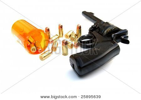 a .45 cal hand gun lays on a white background with .45 ammo comming out of a medicine bottle