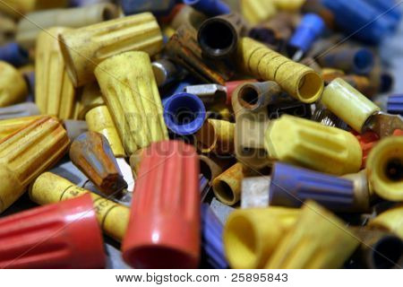 electrical end caps and connections of diffrent sizes and colors piled high upon each other