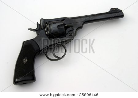 a loaded 45. cal pistol lays isolated on a white background