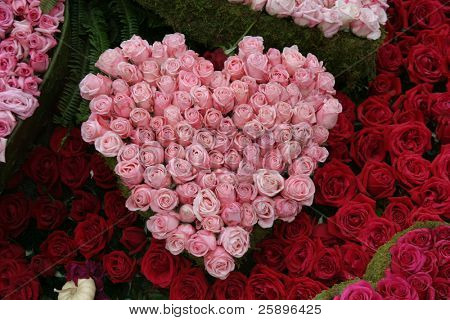 pink roses in the shape of a valentine heart