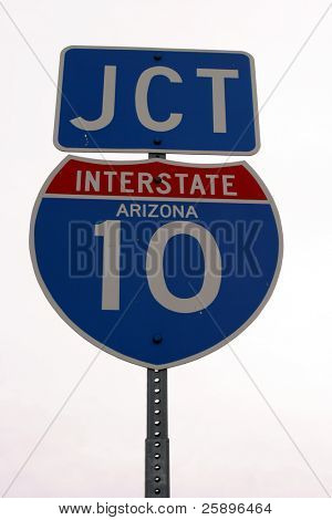 Arizona JCT Interstate 10 sign sits tall on its post against a white background