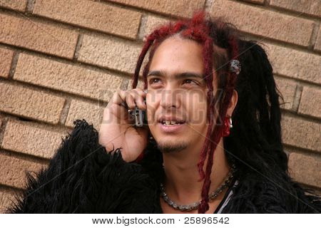 "Juan F. Leon a member of the underground band ""Heavenly Trip To Hell"" talks on his cell phone"
