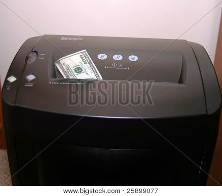 money going down a shredder