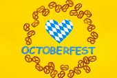 October Fest Concept. Wheat Tasty Sweet Snacks Pretezels, Heart Love In Blue White And Blue Wooden T poster