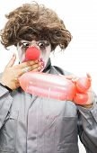 stock photo of titillation  - A Clown Gasps In Shock After Creating A Phallic Symbol Out Of A Balloon Evocatively Inspired By A Naughty Thoughty - JPG
