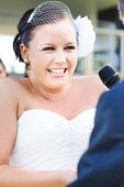 image of heartfelt  - Emotional Bride Crying And Laughing At The Same Time During A Beautiful And Heartfelt Moment Of Wedding Matrimony - JPG