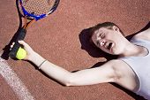 stock photo of tennis elbow  - Clay Court Tennis Player Cries Out For Medical Attention With An Injured Elbow - JPG