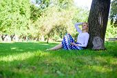 Give Yourself Break And Enjoy Leisure. Find Peaceful Place In Park. Girl Sit On Grass Lean On Tree T poster
