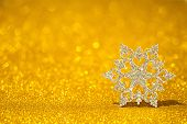 Shining Snowflake On A Golden Radiant Background. Glitter Shine With 3d Shape. poster