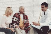 Young Doctor In Coat Visiting Old Couple At Home. Medical Healthcare Concept. Man In White Coat. Sit poster