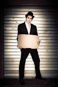 Full Body Vintage Man Holding Blank Cardboard Sign