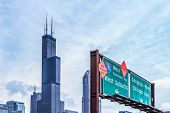 Chicago highway sign with downtown skyline in the background poster