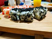 Sushi Roll Japanese Food In Restaurant. California Sushi Roll Set With Salmon, Vegetables, Flying Fi poster