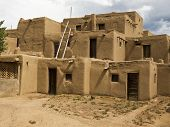 image of pueblo  - A traditional pueblo building in New Mexico. With walls formed of mud and straw the multi-story structure is representative of native American culture.