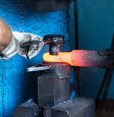 Men Make A Metal Red-hot Detail In An Old Smithy, Close-up, Red-hot Meta, Forging poster