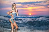 Colorful Sea Sunset With Sensual And Seductive Beautiful Woman With Tattoo. Blond Hair, Swimsuit. Co poster