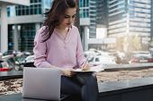 Young Beautiful Freelancer Using Laptop For Work While Sitting Outside, Brunette Businesswoman Worki poster