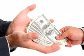 picture of payday  - Hands receiving US Dollars from other hand  - JPG