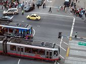 Muni Lightrail Trains Pass Each Other Outside Baseball Park