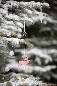 Closeup Of Snowy Evergreen Tree With Nice Christmas Decorations In The Winter Forest. Winter, Christ poster