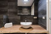Modern Interior Of The Bathroom. The Washbasin Is Made Of White Massive Shell On The Table Of Wood.  poster