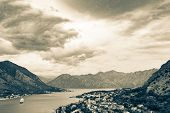 Panoramic View Of City, Sea And Cloudy Sky In Bay Of Kotor, Montenegro Color Toned. Mountain Landsca poster
