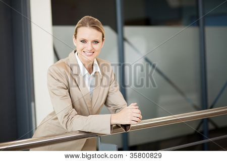 beautiful young businesswoman portrait outside office