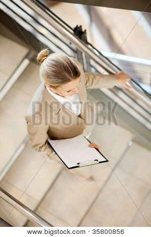 young businesswoman walking down stairs
