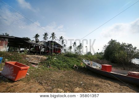 a fishing port filled with colorful containers on the ground on the river bank