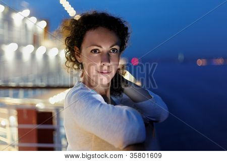 Portrait of woman on deck in evening.