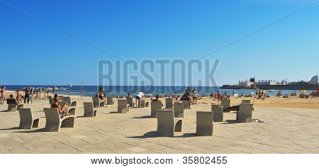 BARCELONA, SPAIN - AUGUST 26: La Nova Icaria Beach on August 16, 2011 in Barcelona, Spain. This beach, 400 meters long, arised with the urban redevelopment on the occasion of the 1992 Olympic Games