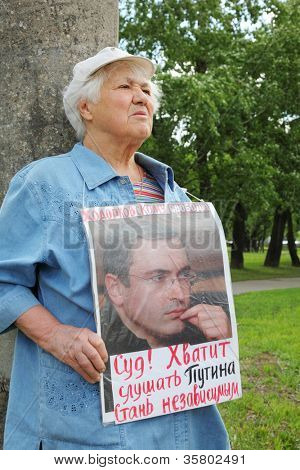 MOSCOW - MAY 24: Supporter of Mikhail Khodorkovsky picketed near building Moscow City Court on May 24, 2011 in Moscow, Russia. Khodorkovsky sentenced for theft of oil to 13 years in prison.