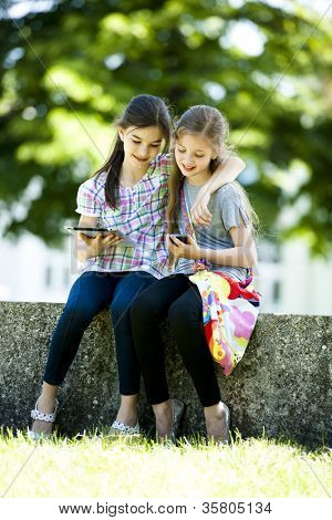 Little friends with PC tablet and mobile phone