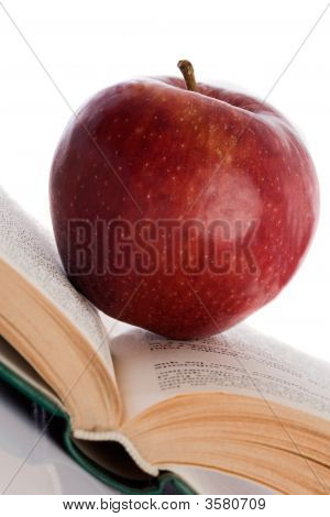 Apple Red On Open Book Inclined