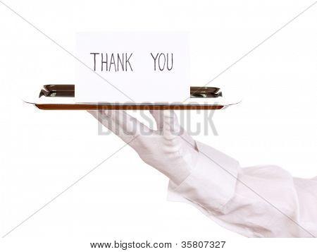 La mano en el guante con bandeja de plata con tarjeta diciendo gracias aislado en blanco