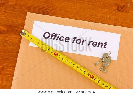 folder with information on the office leasing on wooden background