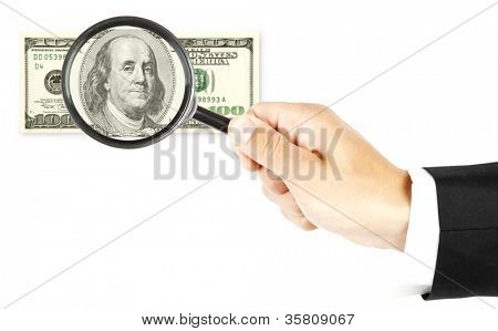 dollar bill under a magnifying glass