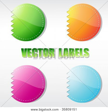 Set of four multicolored round labels. Vector format for your design