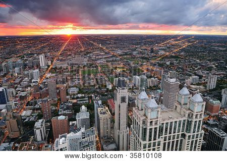 Chicago skyline panorama aerial view with skyscrapers and cloudy sky at sunset.